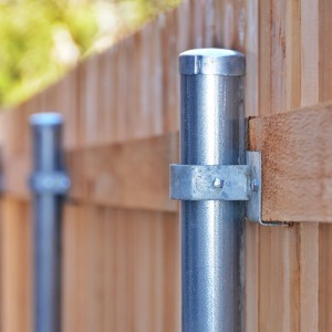 Steel pole on a wooden fence