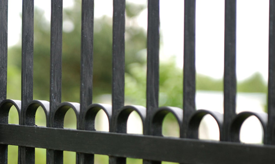 Close up section of wrought iron fence