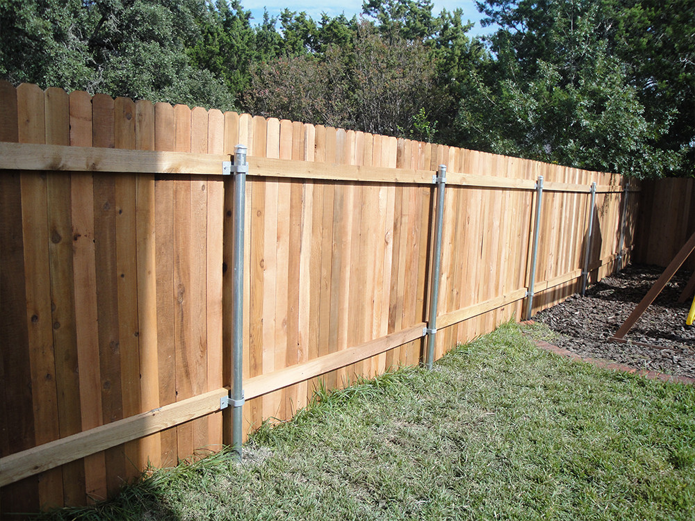 Backyard wooden fence with steel posts