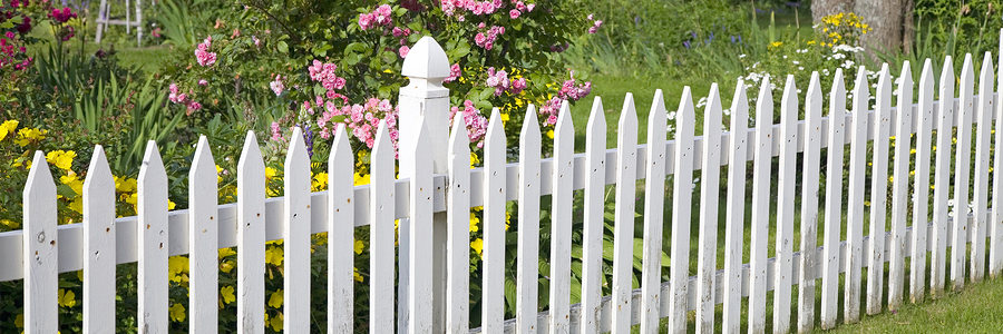 Installation White Picket Fence With Flowers And Garden